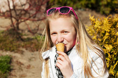 Young girl eating an ice cream Royalty Free Stock Photography