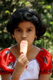 Young girl eating ice lolly Stock Photography