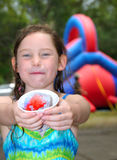 Young Girl Eating Ice Treat Stock Image