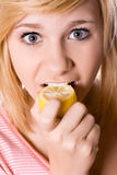 Young girl eating lemon Royalty Free Stock Photos