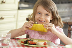 Young Girl Eating Meal In Kitchen Stock Photos