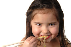 Young girl eating noodle soup royalty free stock images