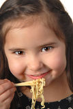 Young girl eating noodle soup Royalty Free Stock Photo