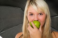 Young girl eating a pear Royalty Free Stock Photography