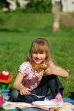 Young girl eating on picnic Royalty Free Stock Photos