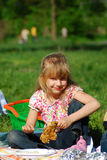 Young girl eating on picnic Stock Image