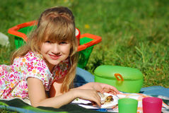 Young girl eating on picnic Royalty Free Stock Photo
