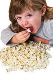 young girl eating a pop corn on bowl Royalty Free Stock Photography