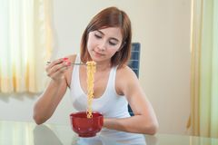Young girl eating ramen noodles Royalty Free Stock Photography