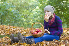 Young girl eating red apple Stock Photography