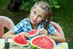 Young girl eating ripe watermelon Royalty Free Stock Image