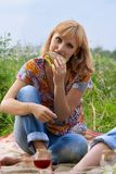 Young girl eating a sandwich at a picnic Stock Photo