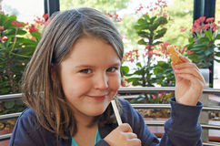 Young girl eating snack Royalty Free Stock Photo