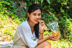Young girl eating snack Stock Photo