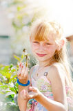 Young girl eating strawberries Royalty Free Stock Photography