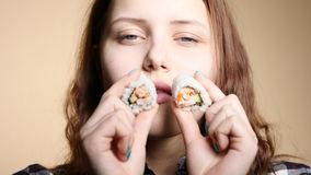 Young girl eating sushi stock video