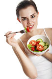 Young girl eating a vegetable salad Stock Image