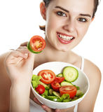 Young girl eating a vegetable salad Royalty Free Stock Photography