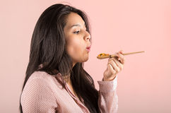 Young girl eating vegetables and rice from a Royalty Free Stock Photography
