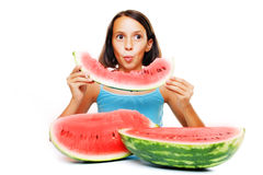 Young girl eating water melon Royalty Free Stock Images