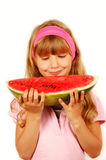 Young girl eating water melon royalty free stock photos