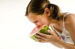 Young girl eating a watermelon Stock Photos