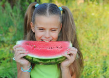 Young girl eating watermelon Stock Photo