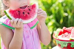 Young girl eating watermelon Stock Images
