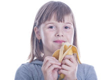 Young girl eats banana Royalty Free Stock Photography