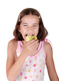 Young girl eats fresh green pear Stock Image
