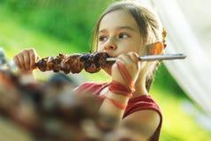 Young girl eats kebab Stock Photo