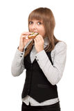 Young girl eats sandwich Stock Photography