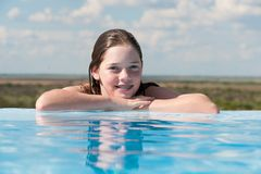 Young girl at the edge of a pool Stock Photography