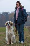 Young girl educate her Bucovina shepherd dog. Young girl educate and motivate her Bucovina shepherd dog, in an autumn scene Stock Photos