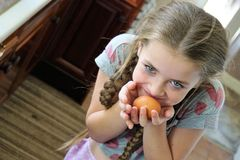 Young girl with egg Stock Photo
