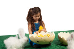 Young girl with egg shape and chicks inside Stock Images