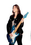 Young girl with electric guitar Stock Images