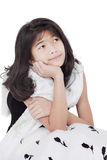 Young girl in elegant dress looking up thinking Royalty Free Stock Images