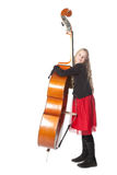 Young girl embraces double bass in studio Stock Photos