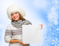 Young girl with empty card on winter background Stock Photo