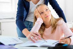 Young girl encounter difficulties during homework Stock Photography