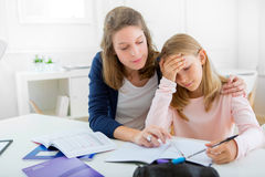 Young girl encounter difficulties during homework. View of a Young girl encounter difficulties during homework stock images