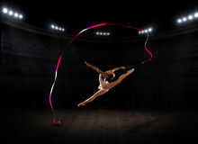Young girl engaged art gymnastic Stock Images