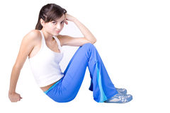 The young girl engaged in fitness. The young beautiful girl engaged in fitness on a white background Stock Images