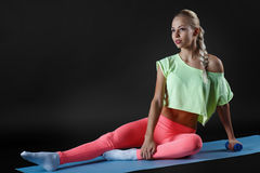 The young girl engaged in fitness Stock Image