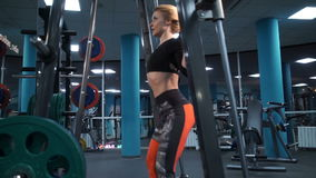 A young girl is engaged in a gym stock video footage