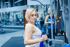 A young girl is engaged in the gym to maintain health and slimness. The girl is targeted on the ideal figure of the body.  royalty free stock photos
