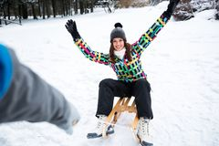 Young girl enjoy while his boyfriend sledding her in beautiful f. Orest, winter concept Stock Photography