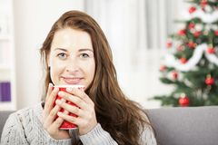 Young girl enjoy hot coffee at christmas Royalty Free Stock Photos