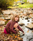 Young Girl Enjoying Autumn royalty free stock photos